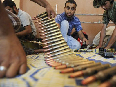 Gaddafi 'remains in Libya against all odds'