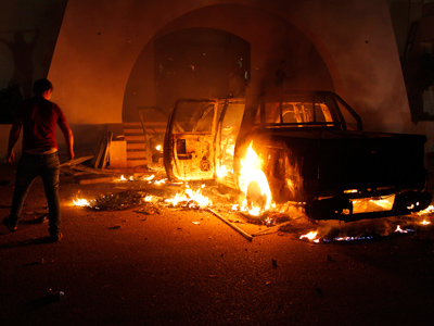Libya to dissolve militias as Islamist strongholds fall