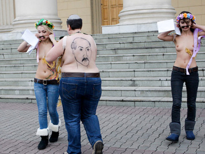 Topless players challenge Lukashenko on Swiss ice