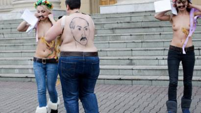 Davos took the shirt off FEMEN's back (VIDEO)