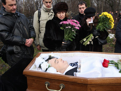 Russia launches two criminal cases into Magnitsky's death