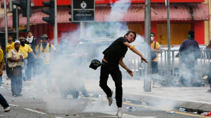 Tear gas for 25,000-strong Malay fair vote rally