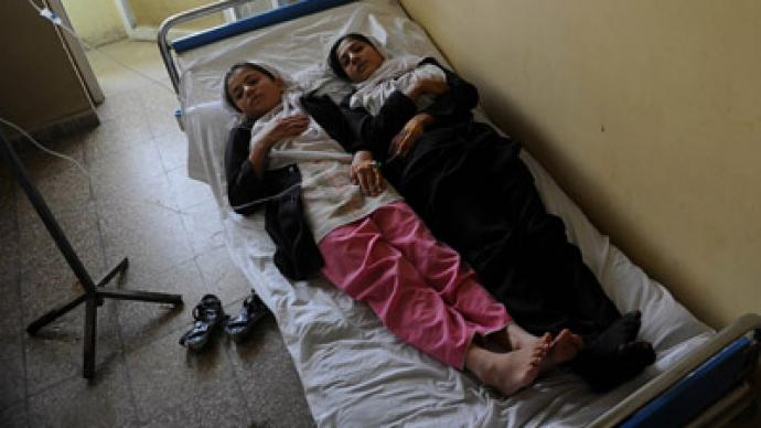 Another mass poisoning in Afghanistan, as women flee fearing Taliban