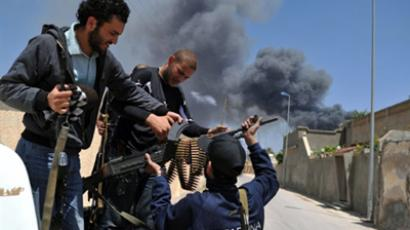 NATO warplanes raid Gaddafi residence and Tripoli port
