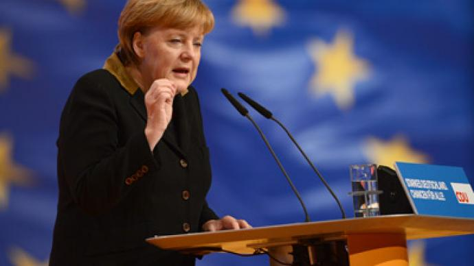 Merkel projected to win third term despite EU outrage