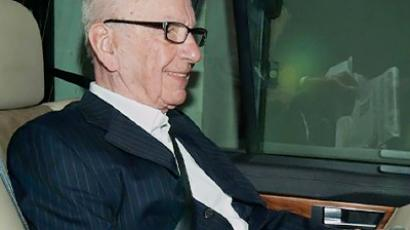 Murdoch says sorry to murdered girl's parents