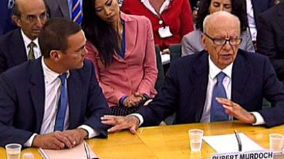 Rupert Murdoch hit with shaving cream during Parliament hearing