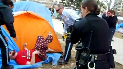 Four arrested as police clear Occupy tent camp in DC