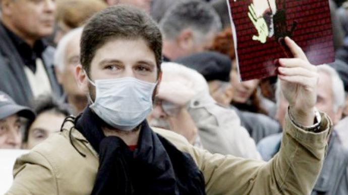 Georgian regime turns on families of opposition