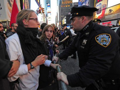 Snow and tough police action fail to deter OWS