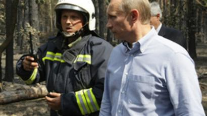 Putin takes part in firefighting
