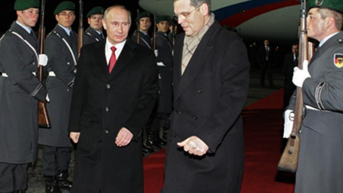 Putin talks post-crisis economy with Merkel