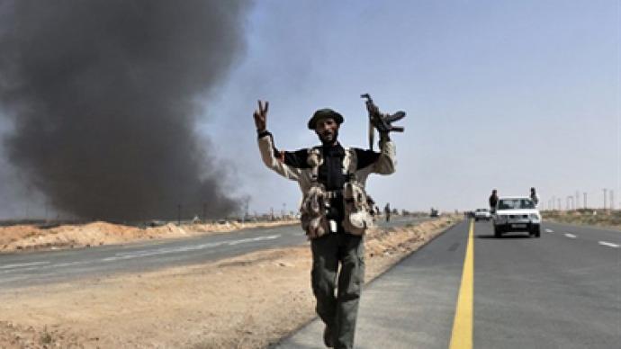 Libyan rebels retreat, forge new plan