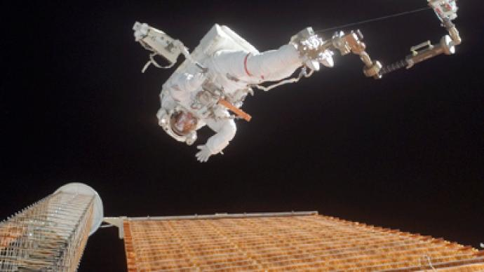 Russian cosmonauts step into space