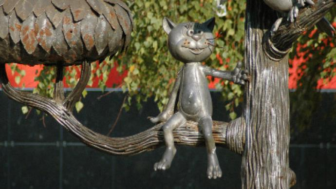 Superstitious fans leave statue of animated cat without whiskers