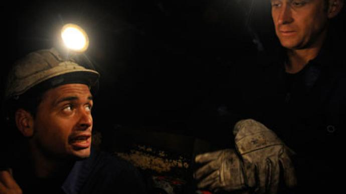 Up to 100 desperate miners barricade underground with explosives