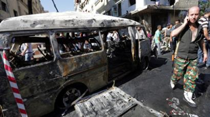 Twin bombings targeting security service buildings rock central Damascus