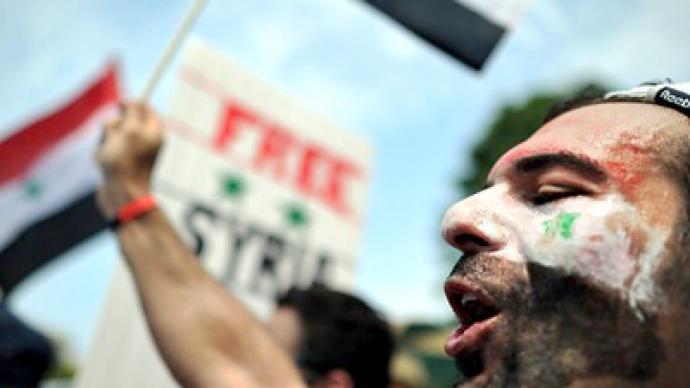 Syria allows political parties