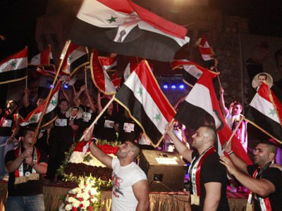 Pro-Assad rally draws thousands to Syrian capital