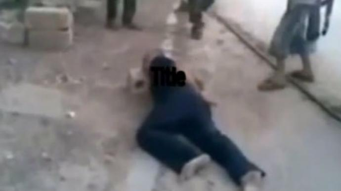 Grisly video allegedly shows Syrian rebels forcing child to behead unarmed prisoner
