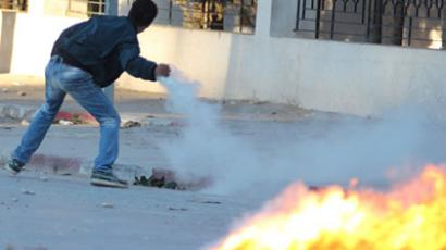 Police station trashed in Tunisia clashes as ruling Islamists reject dissolving government