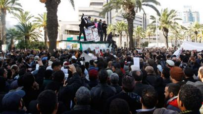 Teargas as thousands protest top opposition leader assassination in Tunisia (PHOTOS)