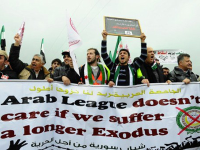 Amid more carnage, Arab League mulls longer stay in Syria