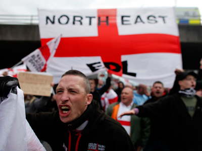 Leader of EDL British far-right group quits citing fears of extremism