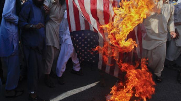 All fired up! Pakistani flag makers cash in on anti-US rage