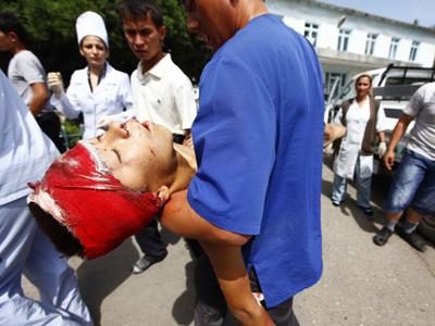 Twelve injured as hundreds attempt to storm Kyrgyz parliament (PHOTOS)