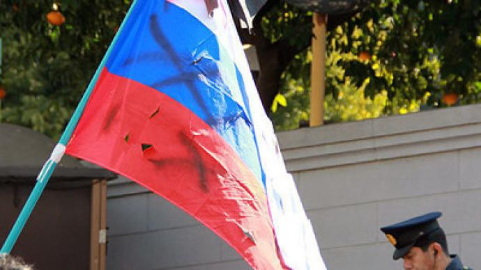 Moscow bans two Japanese groups caught desecrating Russian flag