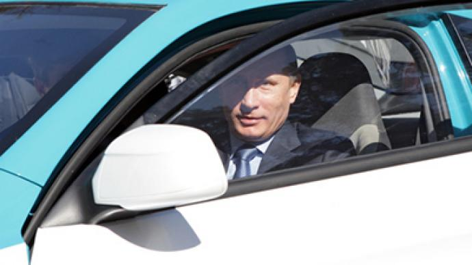 Putin takes Russian hybrid car for a test drive