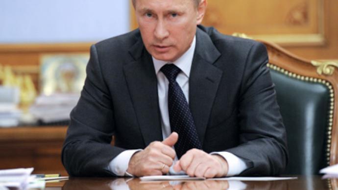 Putin slams 'disgusting' Gaddafi death coverage