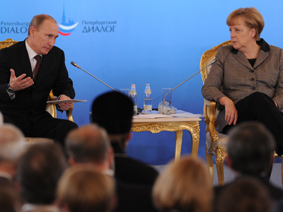 Putin's European blitz: Talking business ties and euro woes