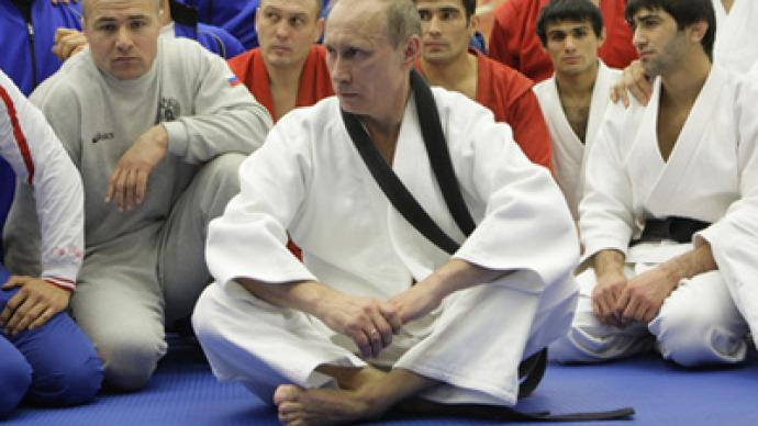 Putin strengthens international friendship with wrestling bouts