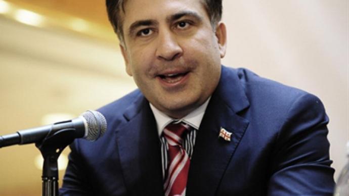 Saakashvili talks tough as Georgian opposition promises change