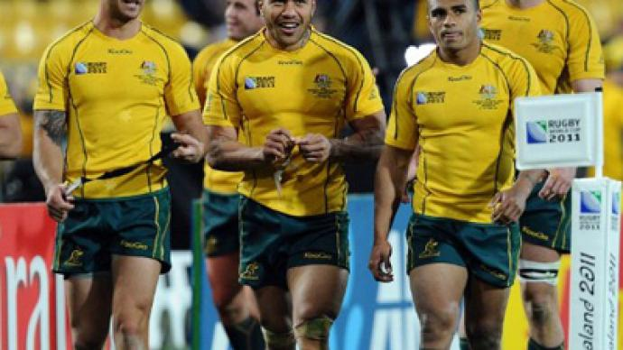 Australia knock reigning champs S. Africa out of RWC