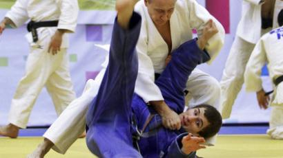 Putin promoted in judo hierarchy