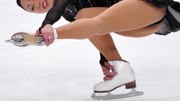 Japanese Miki Ando claims gold at figure skating worlds