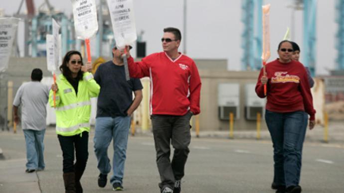 Picketing port employees enter 6th day of talks amid $1 billion per day strike