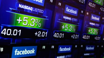 Facebook soars to record high, hits $60 per share for first time