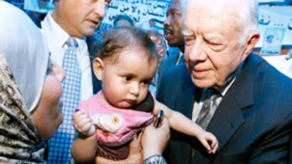 Carter heads to Cuba to dicuss held US prisoner, economy