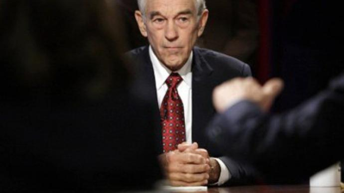 Ron Paul challenges Cain over Fed