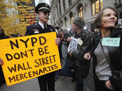Occupy Wall Street to rubber stamp money with anti-corporate slogans