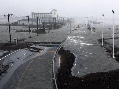 Sandy strikes: Superstorm batters US East Coast