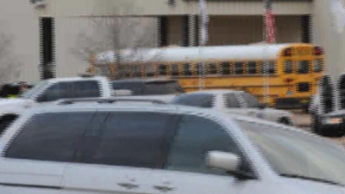 Alabama gunman shoots school bus driver, takes child hostage