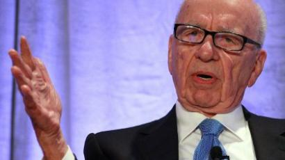 Murdoch gets a Twitter - and his wife is already mad at him