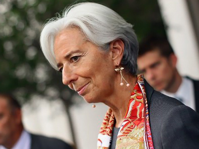 New IMF Chief Christine Lagarde meets with the press for the first time as managing director