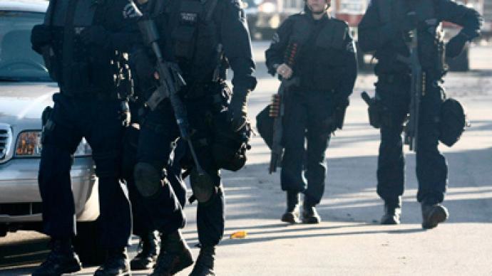 SWAT points gun at 8-year-old grandson