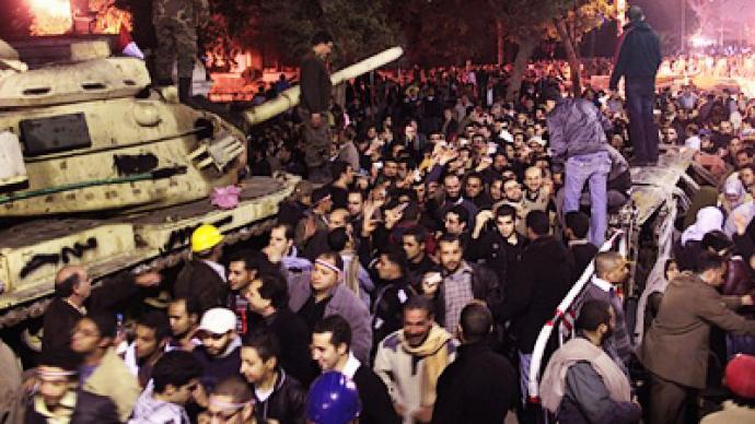 Mubarak refuses to quit, passes power to Suleiman